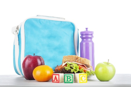 Closeup of a packed school lunch with alphabet blocks. shot in studio photo