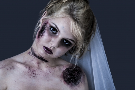 Portrait of bridal zombie with wound and stare creepy photo