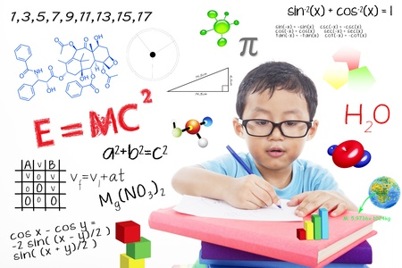 geek: Portrait of genius boy trying to solve formula
