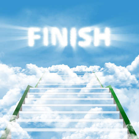 the end: A long stairway leading upward in clouds on a background blue sky with text of FINISH Stock Photo