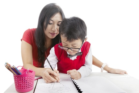 nerd girl: Portrait of elementary school student learn to write with his mother