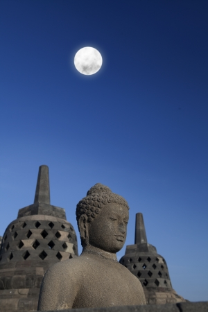 samsara: Shot of statue and stupa at borobudur temple, Yogyakarta, Java, Indonesia.