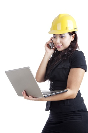 Beautiful Asian engineer holding laptop and a mobile phone isolated on white Stock Photo - 15390500