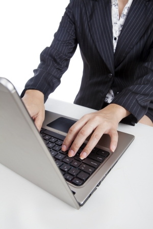 ultrabook: Close up of businesswoman typing on ultrabook laptop computer