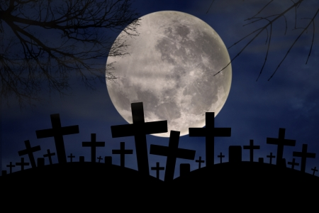 Silhouette of graveyard in the dark of halloween night with full moonlight photo