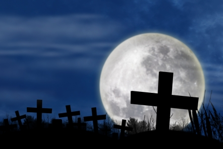 spooky graveyard: Spooky graveyard with cross and full-moon, in the dark night of halloween Stock Photo