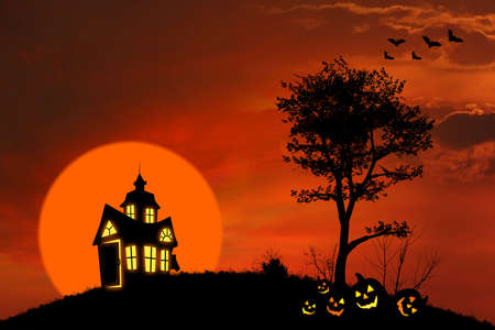 Halloween background with spooky house and pumpkins on the hill photo