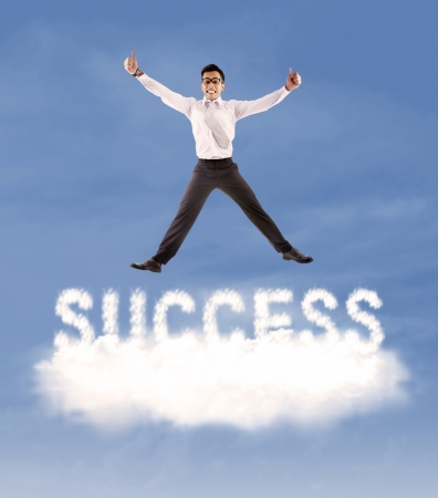 thumbsup: Successful asian businessman with thumbs-up jumping over the cloud