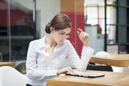 Portrait of businesswoman using digital tablet at cafe Stock Photo - 15474201