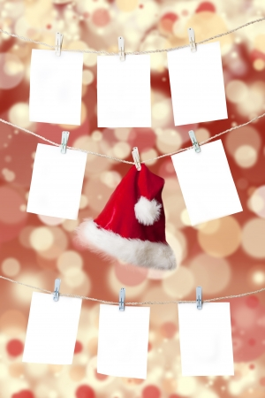 Christmas pricing tags and santas hat hanging on the rope with christmas defocused light background photo