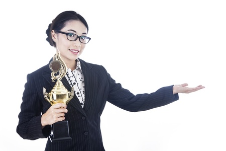A proud businesswoman presenting a trophy to the winner by showing her hand photo