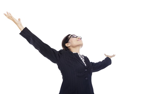 accomplishments: Victorious businesswoman stretching her arms because of her accomplishments