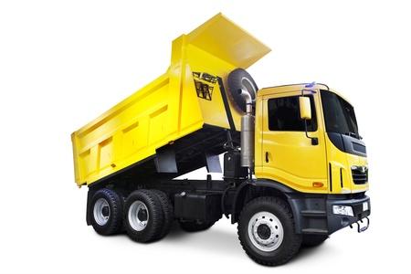 volteo: Un gran camión volquete amarillo aislado en blanco Foto de archivo