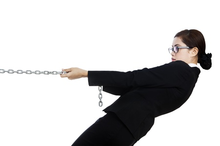 Businesswoman is pulling silver chain and is taking control photo