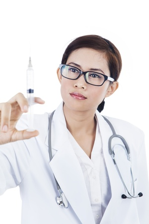 Female doctor is holding a stryinge isolated in white photo