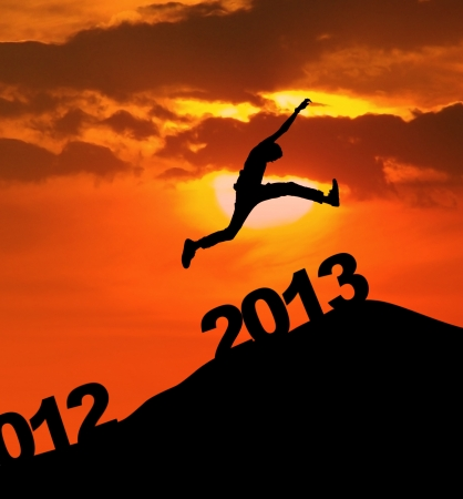Man jump over 2013 number to embrace the new year photo