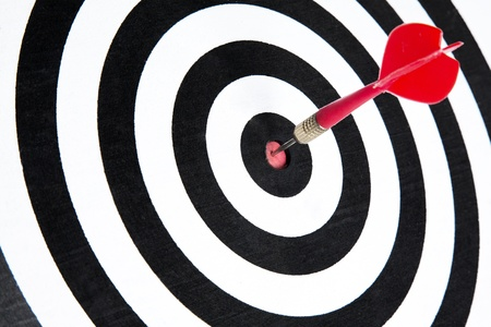 bull     s eye: One dart is hitting perfectly on the black dart board with good accuracy Stock Photo