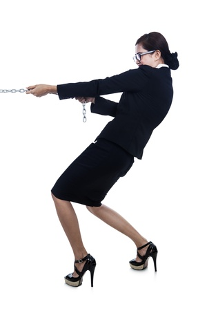 A businesswoman is trying to pull the chain and taking control with her strength photo