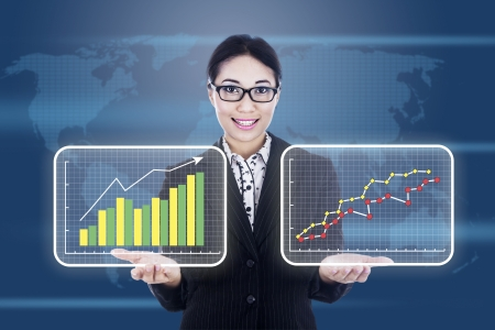 advantages: Businesswoman is presenting 2 different diagrams showing improvement or profit of a company