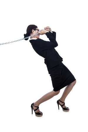 businesswoman is pulling chain to go further with her career photo