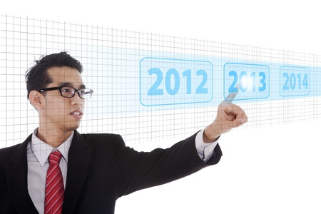 Businessman pressing high tech type of modern buttons on a virtual background Stock Photo - 16011221