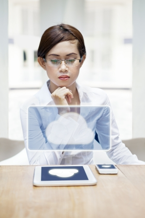 The modern businesswoman using technologies device with cloud service photo