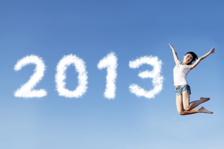 A female jumping to welcome the new year of 2013 photo