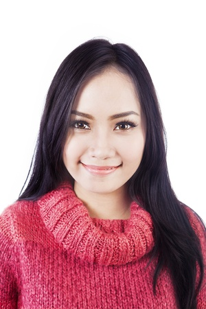 Portrait of beautiful long black hair woman wearing red sweater isolated on white Stock Photo - 16085497