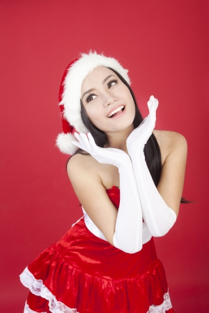 Portrait of cute christmas woman wearing christmas costume. shot over red background photo