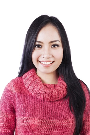 sweater girl: Portrait of beautiful long black hair woman wearing red sweater isolated on white