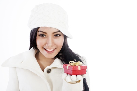 Portrait of beautiful woman offering a christmas gift. isolated on white background photo