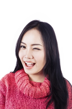 Portrait of beautiful woman winked her eye and wearing red sweater isolated on white Stock Photo - 16085495