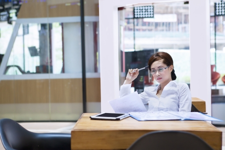 Businesswoman is thinking seriously about her work while sitting at the office photo