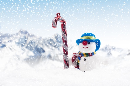 A stripy candy cane and snow man outdoor during Christmas season Stock Photo - 16149513
