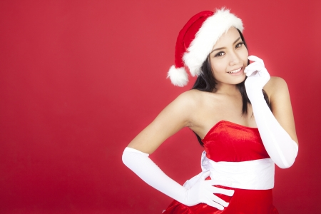 Portrait of cute christmas woman wearing christmas costume. shot over red background Stock Photo - 16085489