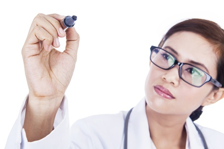 doctor writing: Female doctor is writing something on copyspace with white background Stock Photo