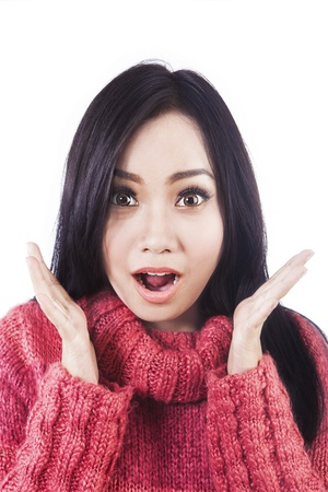 Portrait of surprised beautiful woman wearing red sweater isolated on white photo