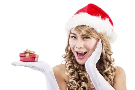 Portrait of surprised christmas woman holding a red gift box. isolated on white photo