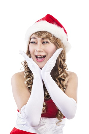 Portrait of sweet christmas woman looking at copy space. isolated on white background photo