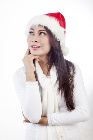 Portrait of a young woman wearing winter clothes thinking and looking at copy space photo