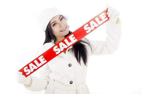 promotion girl: Portrait of fashionable woman showing banner of winter sale. isolated on white background