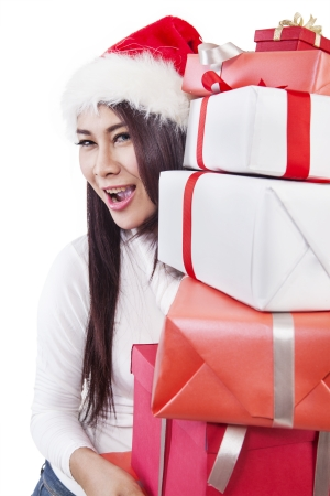 A woman holding Christmas gifts wrapped in white and red paper isolated in white Stock Photo - 16128225