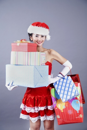 Beautiful asian woman with christmas presents and shopping bags photo