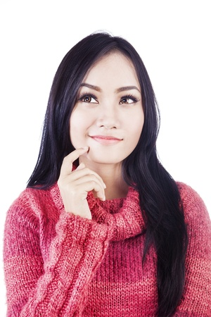 Asian woman is thinking of something isolated in white photo