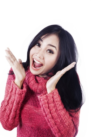 amaze: Beautiful woman is expressing her surprise happily wearing pink jumper isolated in white