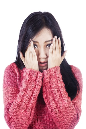 affraid: Beautiful Asian woman covering her face with hands to show fear expression isolated in white Stock Photo