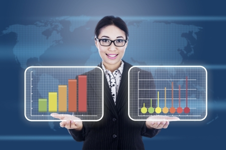 Portrait of asian businesswoman showing business diagram on a graphic interface Stock Photo - 16494349