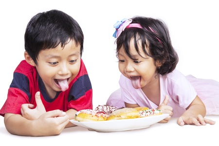 eat out: Brother and sister is having dinner together, isolated in white
