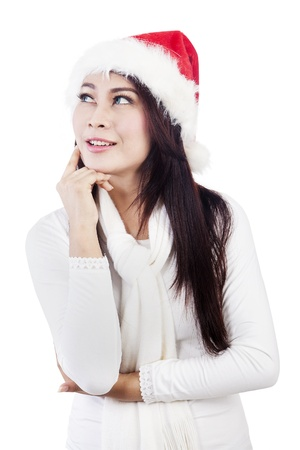 Portrait of happy dreaming christmas woman wearing winter clothes  isolated on white photo