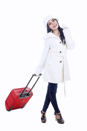Beautiful young woman traveller with red suitcase for winter holidays Stock Photo - 16495194
